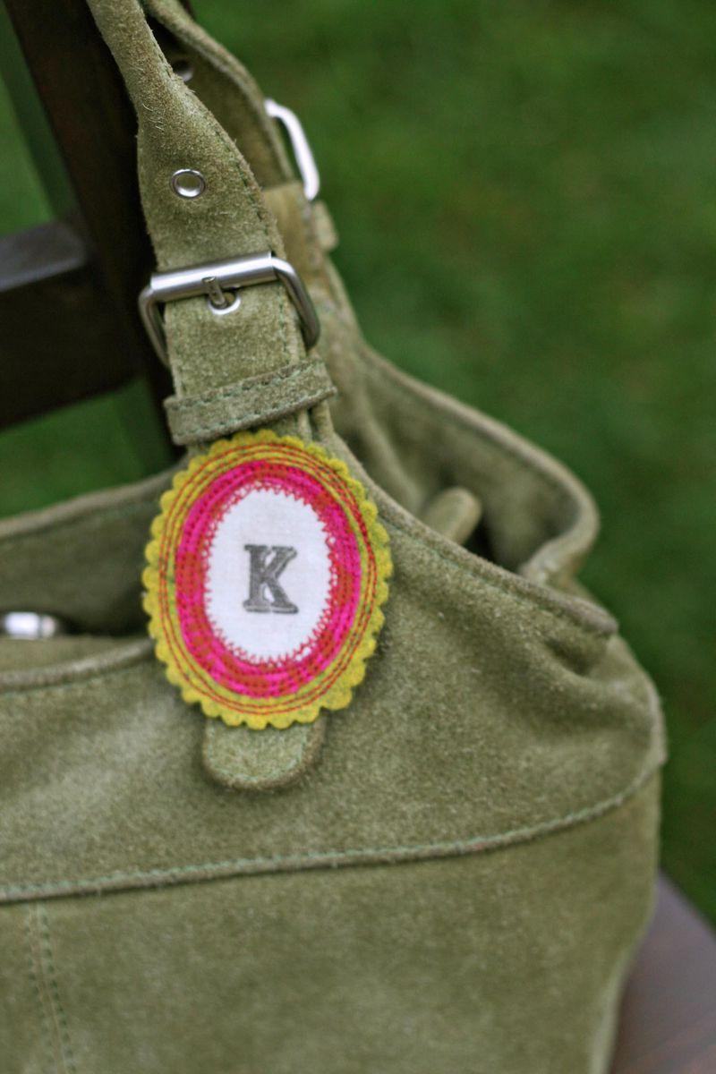 Oval K brooch